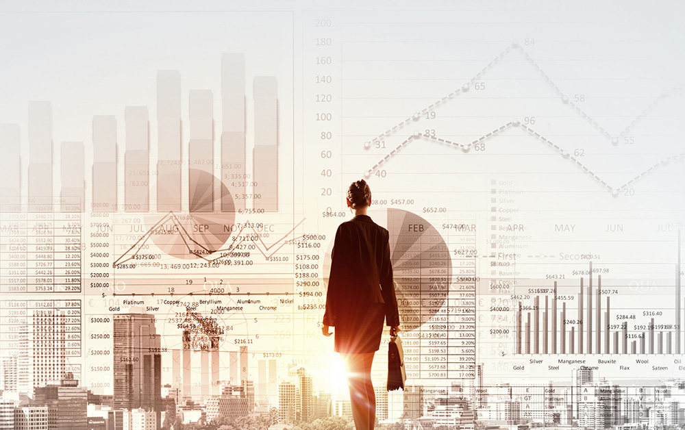 Businesswoman looks out over graphs