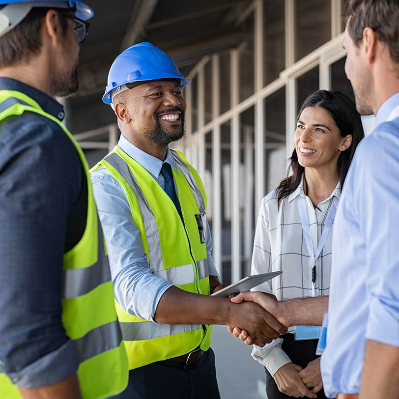 Shaking hands at a construction site