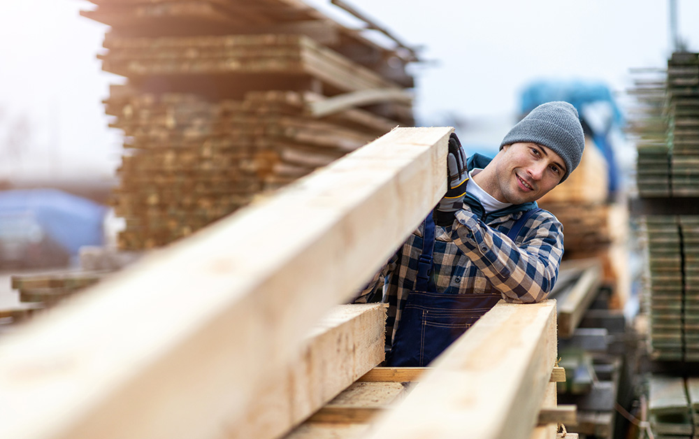 A man works in a lumber yard