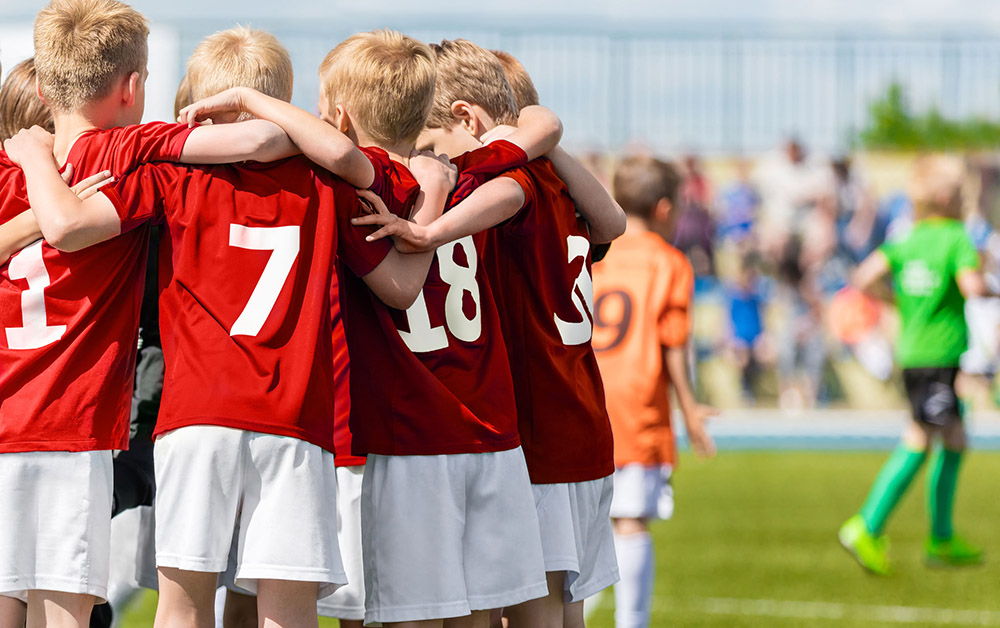 Youth athletes in a huddle